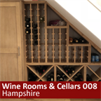 Compact bespoke under stairs wine racking with additional cupboard storage in Hampshire