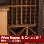 Under stairs wine rack in Hertfordshire using oak racks and cubes