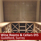 Basement wine room in Guildford using cubes, racks and shelves