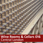Basement wine cellar in London using pine cubes and racks