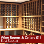 Large underground wine cellar using solid pine racking in East Sussex